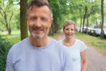 Middle-aged couple walking along a country road