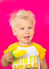 kid eating tasty ice cream on pink background