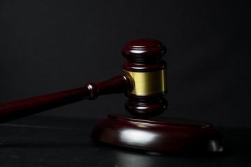 Judge gavel on black wooden background
