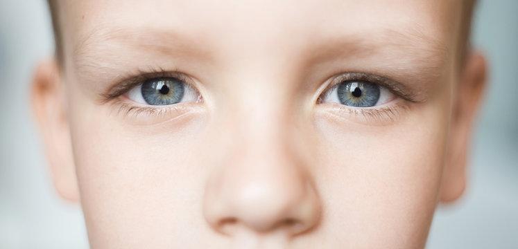 Closeup of beautiful boy eye. Beautiful grey eyes macro shot.