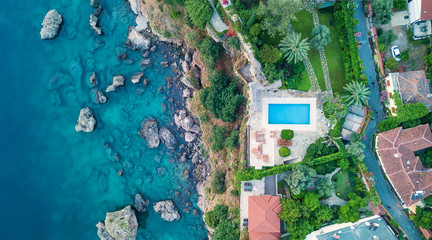 Aerial view at the pool and sea. Beautiful natural landscape at the summer time Wall mural