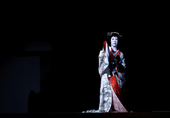 Geisha, a traditional Japanese female entertainer, performs a dance during a press preview at the annual Azuma Odori Dance Festival