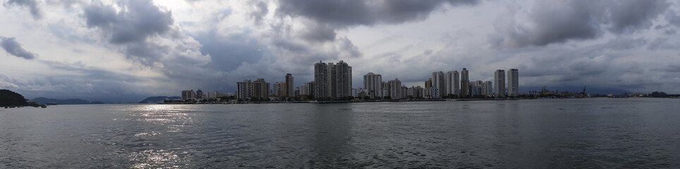 City with buildings and beach at the same time, Guaruja city, South America, Brazil