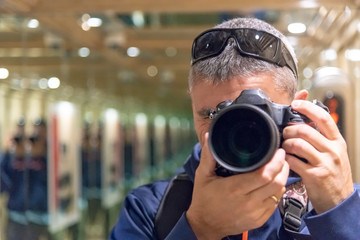 Multiple images of photographer shooting mirror