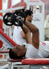 A man exercises at the gym during the holy fasting month of Ramadan, in Benghazi