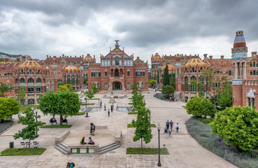 BARCELONA, SPAIN - MAY 12, 2018: People visit Recinte Modernista de Sant Pau. The city attracts 10 million tourists annually
