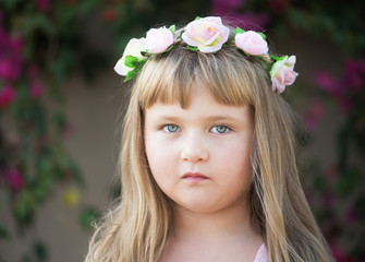 Lovely little baby girl with daisy wreath on her head
