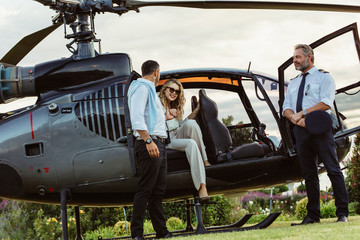 Couple traveling by a private helicopter Wall mural