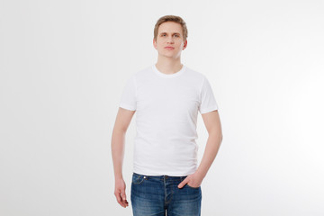Front view. Young man wearing blank white t-shirt isolated on white background. Copy space. Place for advertisement. Mock up. Summer shirt.