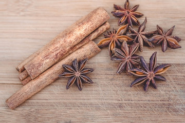 cinnamon and star anise on a wooden board