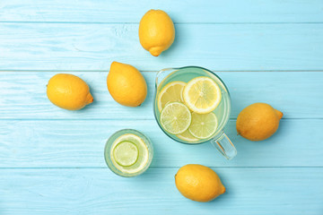 Flat lay composition with delicious natural lemonade on color wooden background