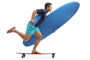 Surfer with a surfboard riding a longboard
