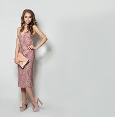 Stylish Woman in Summer Dress Posing against White Studio Background, Fashion Portrait