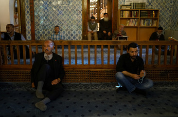 People rest in a mosque in Ankara
