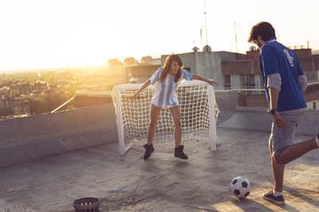 Couple playing football