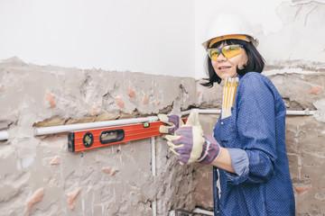 Smiling woman using Water Ruler Tool