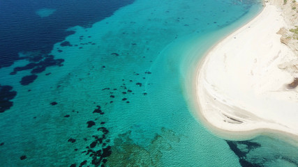 Aerial drone bird's eye view photo of tropical caribbean sandy beach with emerald crystal clear waters