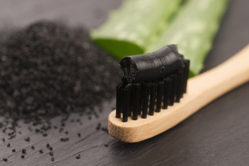 Toothbrush with black charcoal toothpaste with aloe vera