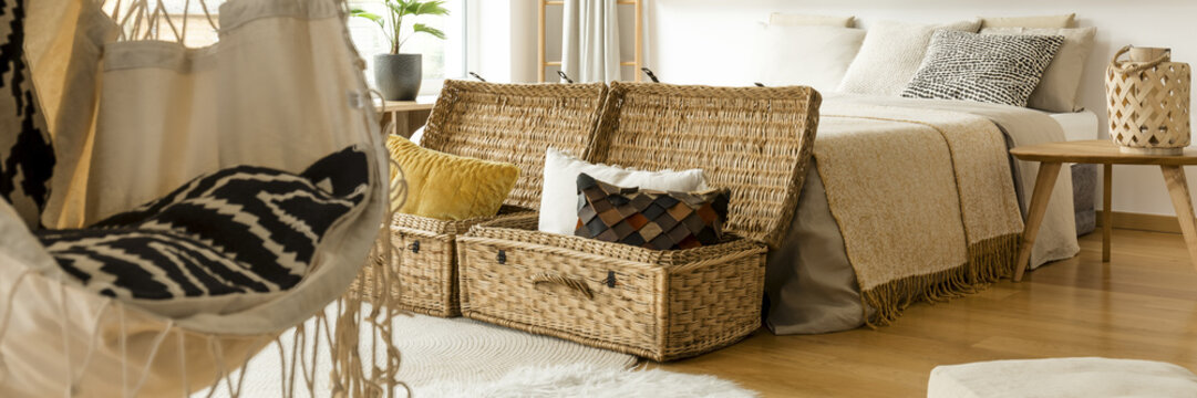 Pillows in straw baskets