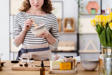 Woman making organic face cream