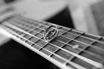Wedding rings on guitar strings
