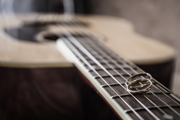 Two Wedding Rings on the Guitar Strings