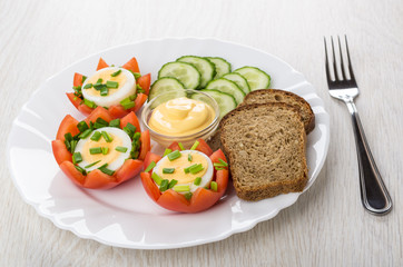 Tomatoes with boiled eggs, cucumbers, mayonnaise, bread and fork