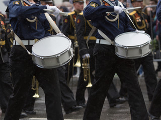 Navy orchestra participate in parade.