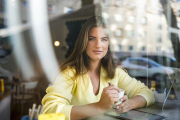 Portrait of smiling young woman in cafe