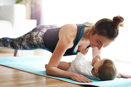 Mother exercising with daughter