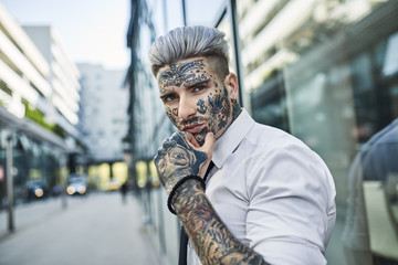 Young businessman with tattooed face
