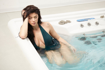 beautiful brunette relaxing at spa