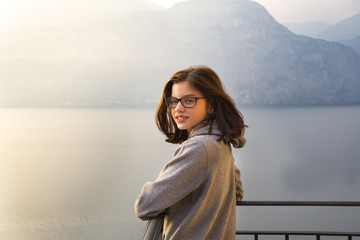 Italy, Brenzone, portait of smiling girl on balcony