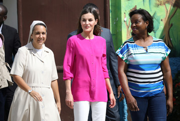 Spain's Queen Letizia and Haiti's first lady Martine Moise walk during a visit to the Center of the Sisters of Saint Vincent de Paul in Cite Soleil, Port-au-Prince