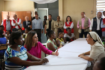 Spain's Queen Letizia and Haiti's first lady Martine Moise speak to a nun during a visit to the Center of the Sisters of Saint Vincent de Paul in Cite Soleil, Port-au-Prince