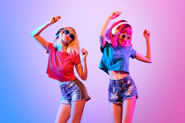 Wall Mural - Two DJ Girl Hipster with Fashion Hairstyle Dance.