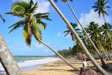 Happy tourist on the Limon beach wild and hard to reach on the south coast of Dominican Republic