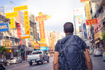 men backpacker looking at the famous place of Yaowarat road in Chinatown Bangkok during day, Thailand , Southeast asia .