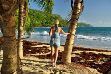 Happy tourist on the Rincon beach wild and hard to reach on the Samana peninsula in Dominican Republic