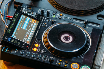 DJ Equipment Deck With Music Track Control And Mixer At Club Night Party