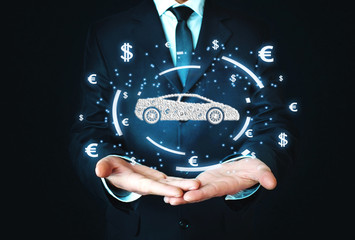 Businessman holding car and currency symbols. Concept of buy car