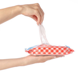 Packing wet wipes in hands on a white background isolation