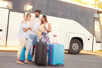 Young friends travel on vacation by bus