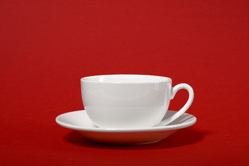 one simple coffee cup on red color background, closeup photo