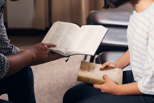 Christians and Bible study concept.Meeting the people of Christ religion, Group of christians studying the word of god in church and praying together