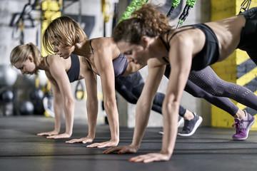 Sportive girls training in gym
