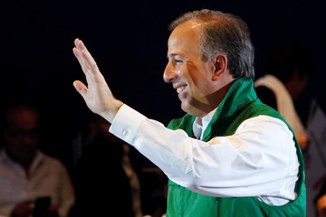PRI presidential candidate Jose Antonio Meade waves during a meeting with people with disabilities in Mexico City