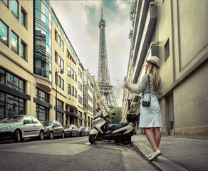 Woman tourist with map on the street near the Eiffel tower in Paris