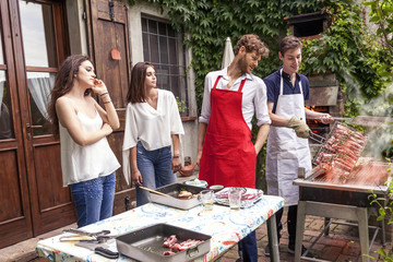 group of friends preparing a barbecue party