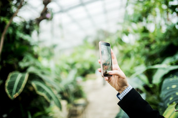 Making a photo in the greenhouse.